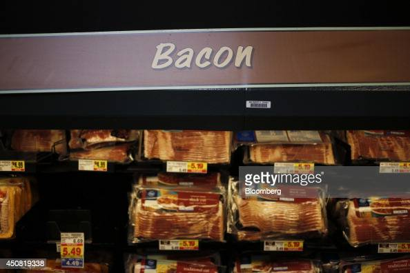 Packages of bacon are displayed for sale inside a Kroger Co grocery store in Louisville Kentucky US on Tuesday June 17 2014 The Kroger Co is...