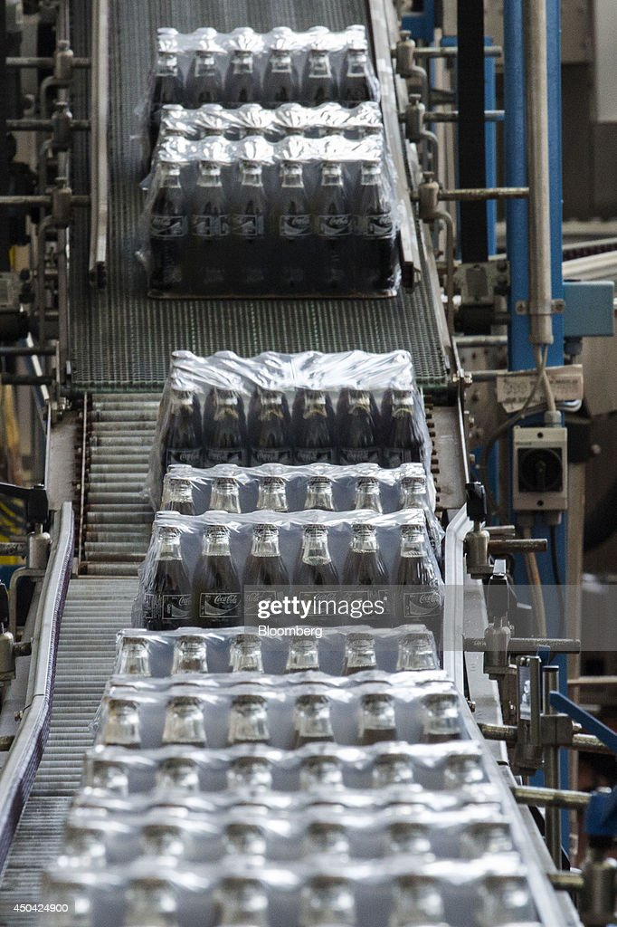 Packages of Coca-Cola Light, also known as diet Coke, roll along a conveyor belt towards the end of the production line at the Lanitis Bros Ltd. bottling plant, part of the Coca-Cola Hellenic Group, in Nicosia, Cyprus, on Tuesday, June 10, 2014. Zug, Switzerland-based Coca-Cola Hellenic Bottling Co., which distributes Coca-Cola products in countries including Russia, wants to move away from using imported sugar for its Russian operations by 2015. Photographer: Andrew Caballero-Reynolds/Bloomberg via Getty Images