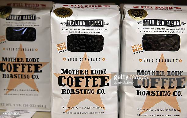 Packages of coffee beans are displayed at CalMart Grocery on March 27 2014 in San Francisco California Food prices are on the rise and expected to...
