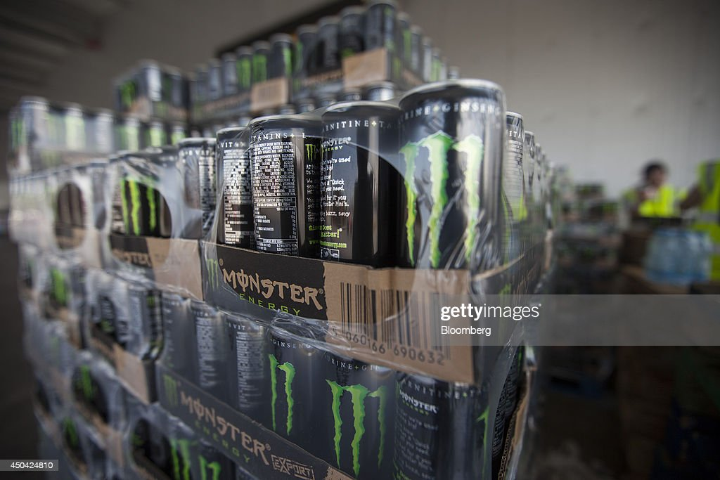 Packages of Monster Energy drinks cans sit in a storage area ahead of distribution at the Lanitis Bros Ltd. bottling plant, part of the Coca-Cola Hellenic Group, in Nicosia, Cyprus, on Tuesday, June 10, 2014. Zug, Switzerland-based Coca-Cola Hellenic Bottling Co., which distributes Coca-Cola products in countries including Russia, wants to move away from using imported sugar for its Russian operations by 2015. Photographer: Andrew Caballero-Reynolds/Bloomberg via Getty Images