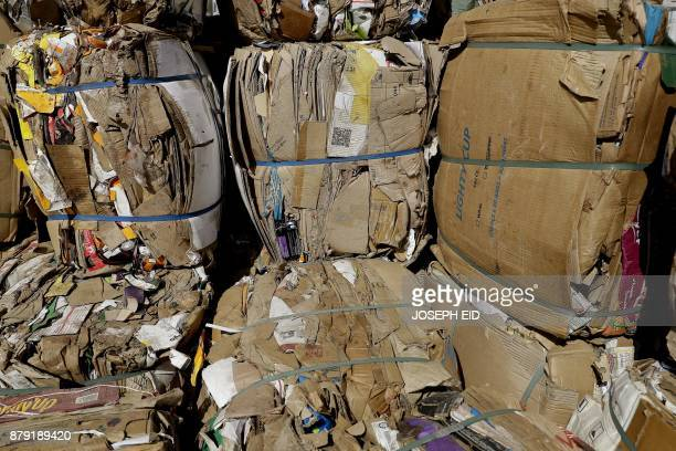 Packages of paper are seen at a waste treatment plant in the area of Monteverde east of Beirut on October 27 2017 The Lebanese divers plunge below...