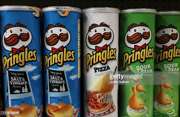 Packages of Pringles potato chips are displayed on a shelf at a market on April 5 2011 in San Francisco California Diamond Foods Inc has agreed to...