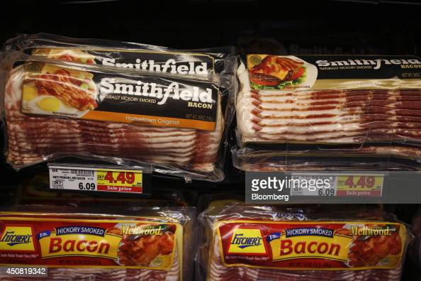 Packages of Smithfield Foods Inc bacon are displayed for sale inside a Kroger Co grocery store in Louisville Kentucky US on Tuesday June 17 2014 The...