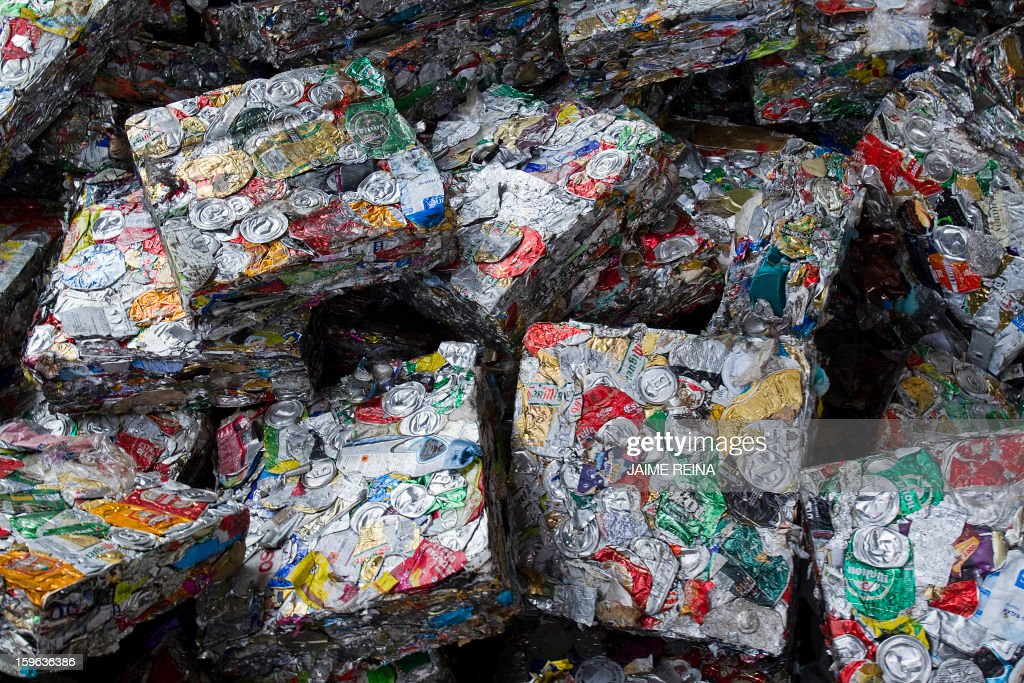 Packages of tin cans for reclycing are pictured at a waste treatment plant in Palma de Mallorca on January 17, 2013. AFP PHOTO / Jaime REINA