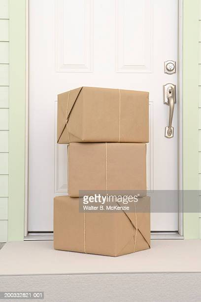 Packages outside front door of house