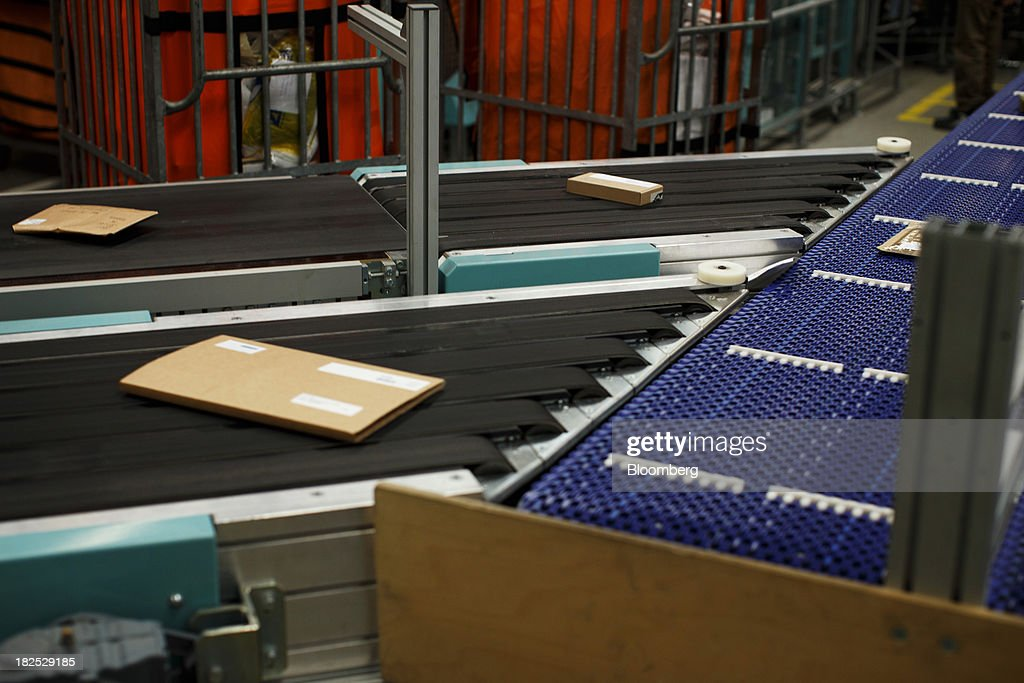 Packages pass along a conveyor belt at the PostNL NV mail sorting center in Nieuwegein, Netherlands, on Friday, Sept. 27, 2013. PostNL NV rose the most in two months on Sept. 19 after the Dutch postal operator raised its full-year forecast and announced higher prices for stamps. Photographer: Jasper Juinen/Bloomberg via Getty Images