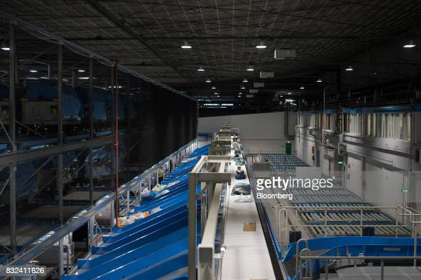 Packages pass along a conveyor inside the KLM Cargo center operated by Air FranceKLM Group at Schiphol airport in Amsterdam Netherlands on Tuesday...