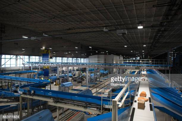 Packages pass along conveyors inside the KLM Cargo center operated by Air FranceKLM Group at Schiphol airport in Amsterdam Netherlands on Tuesday Aug...