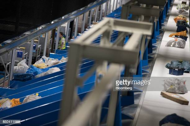 Packages sit in mail chutes and pass along a conveyor inside the KLM Cargo center operated by Air FranceKLM Group at Schiphol airport in Amsterdam...