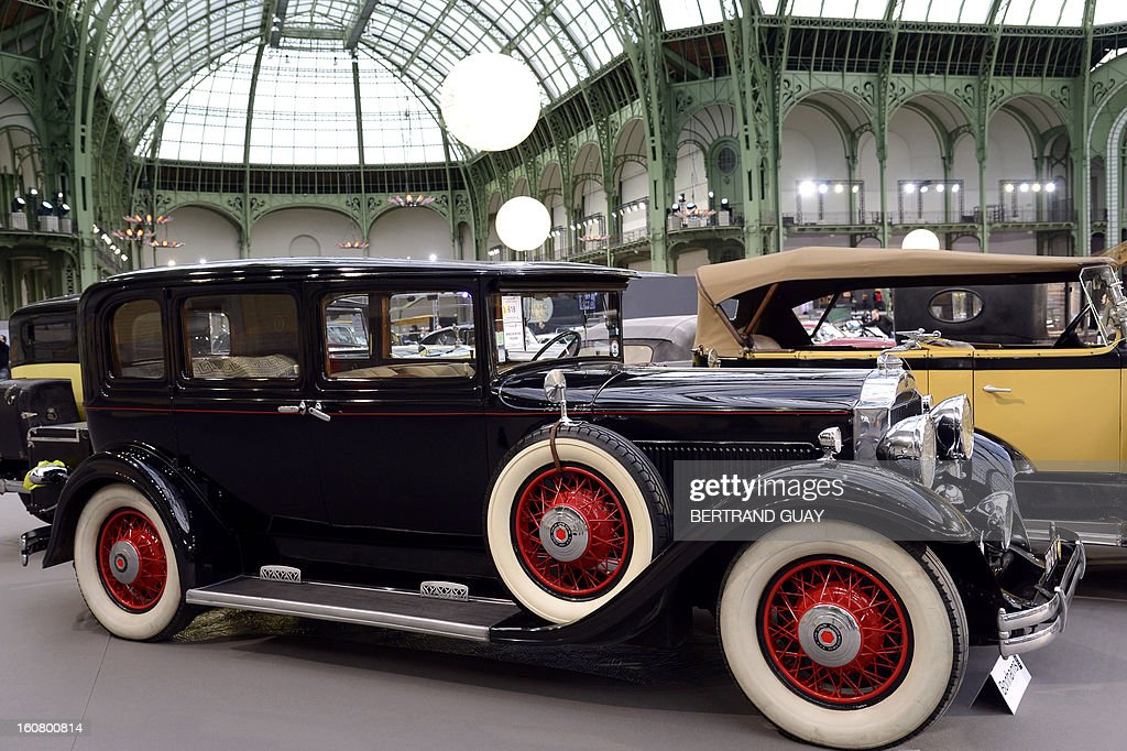 A Packard Standard Eight 833 Limousine (1931) is pictured as luxury vintages cars are displayed at an auction at the Grand Palais on February 6, 2013 in Paris. 125 vintage motor cars, 100 collection motorbikes and a 1920's Gipsy Moth plane by De Havilland, will be presented at the Bonhams auction on February 7. AFP PHOTO BERTRAND GUAY