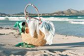 Packed beach bag on beach