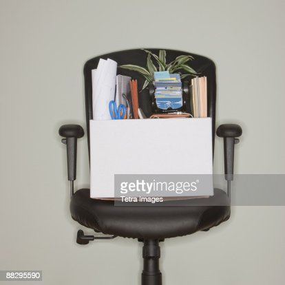 Packed box on office chair