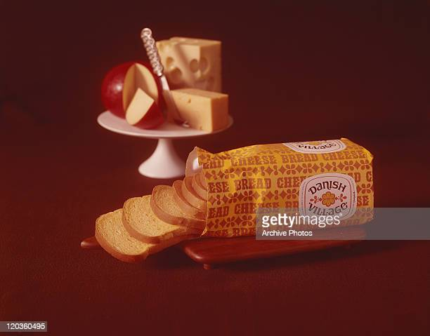 Packed bread slices, apple, cheese, and butter on red background