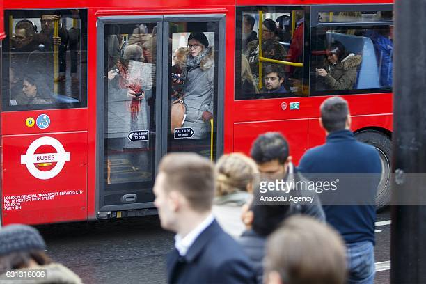 A packed bus goes past commuters queuing for buses outside King's Cross station as London Underground services are severely disrupted due to members...