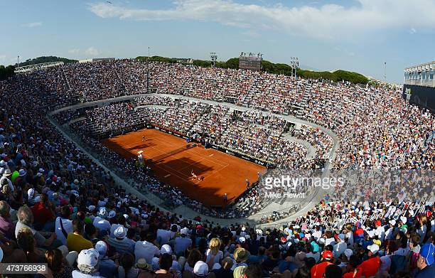 A packed Centre Court watches the Men's Singles Final between Novak Djokovic of Serbia and Roger Federer of Switzerland on Day Eight of The...