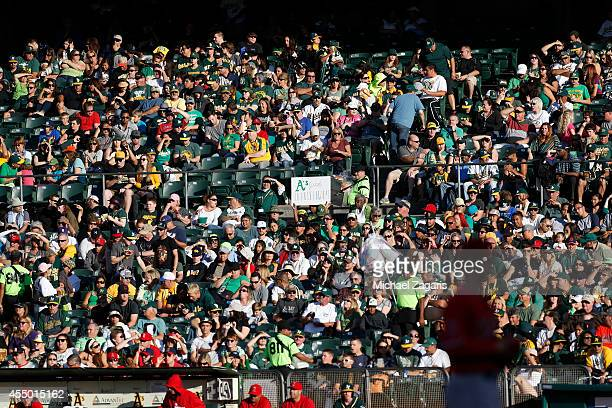 A packed crowd watches the game between the Oakland Athletics and the Los Angeles Angels of Anaheim at Oco Coliseum on August 23 2014 in Oakland...