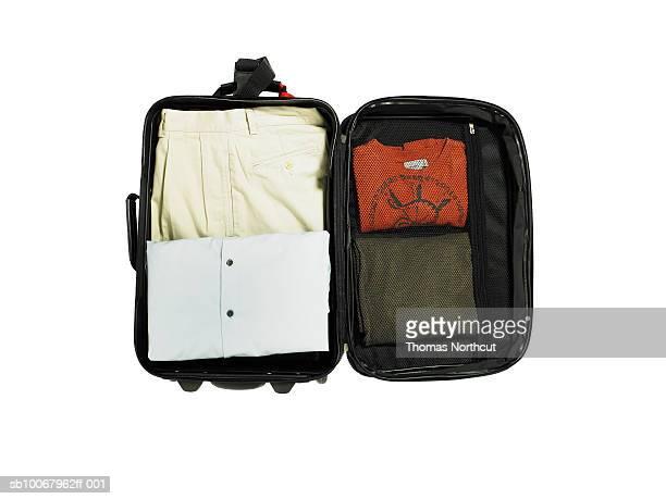 Packed luggage on white background