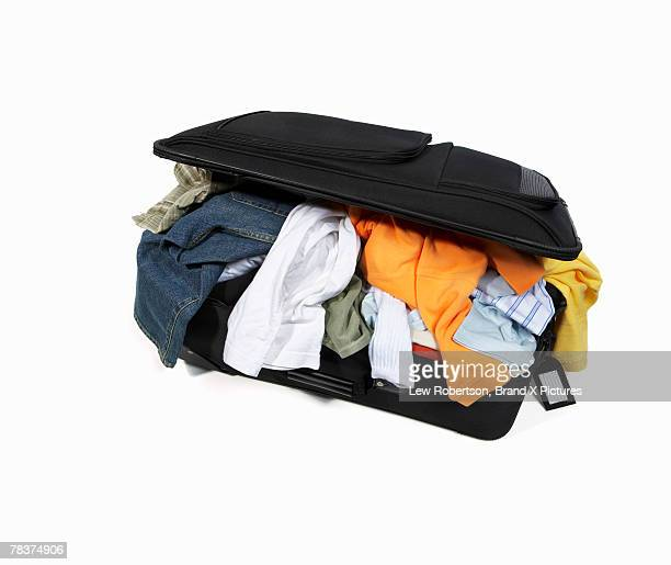 Packed suitcase with clothing