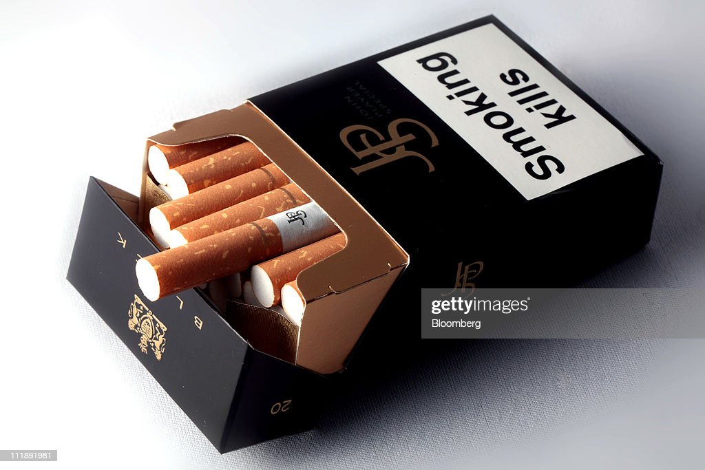 A packet of John Player cigarettes, produced by Imperial Tobacco Group Plc, sit arranged for a photograph in London, U.K., on Thursday, April 7, 2011. The global market for cigarettes excluding China, which is largely closed to foreign tobacco companies, will probably shrink by 2.5 percent in 2011, BAT Chief Executive Officer Nicandro Durante said Feb. 24. Photographer: Jason Alden/Bloomberg via Getty Images