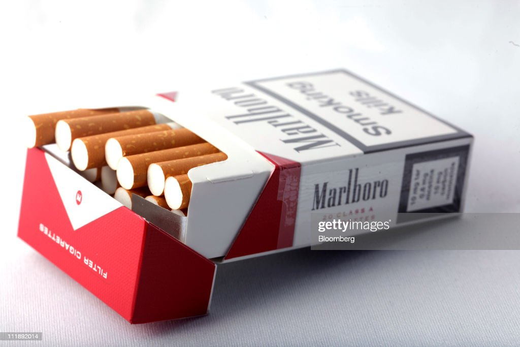 A packet of Marlboro cigarettes, produced by Altria Group Inc., sit arranged for a photograph in London, U.K., on Thursday, April 7, 2011. The global market for cigarettes excluding China, which is largely closed to foreign tobacco companies, will probably shrink by 2.5 percent in 2011, BAT Chief Executive Officer Nicandro Durante said Feb. 24. Photographer: Jason Alden/Bloomberg via Getty Images