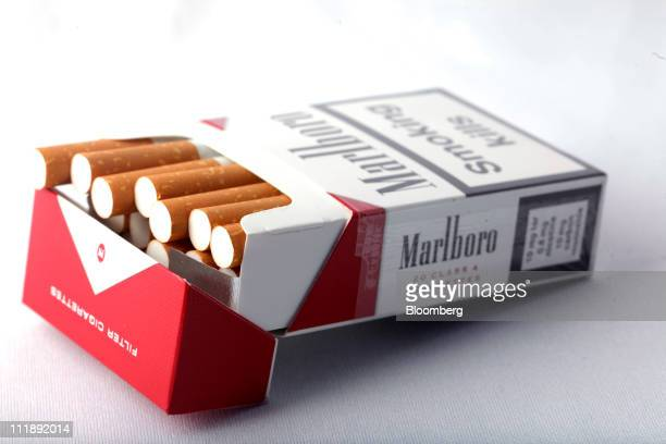 A packet of Marlboro cigarettes produced by Altria Group Inc sit arranged for a photograph in London UK on Thursday April 7 2011 The global market...