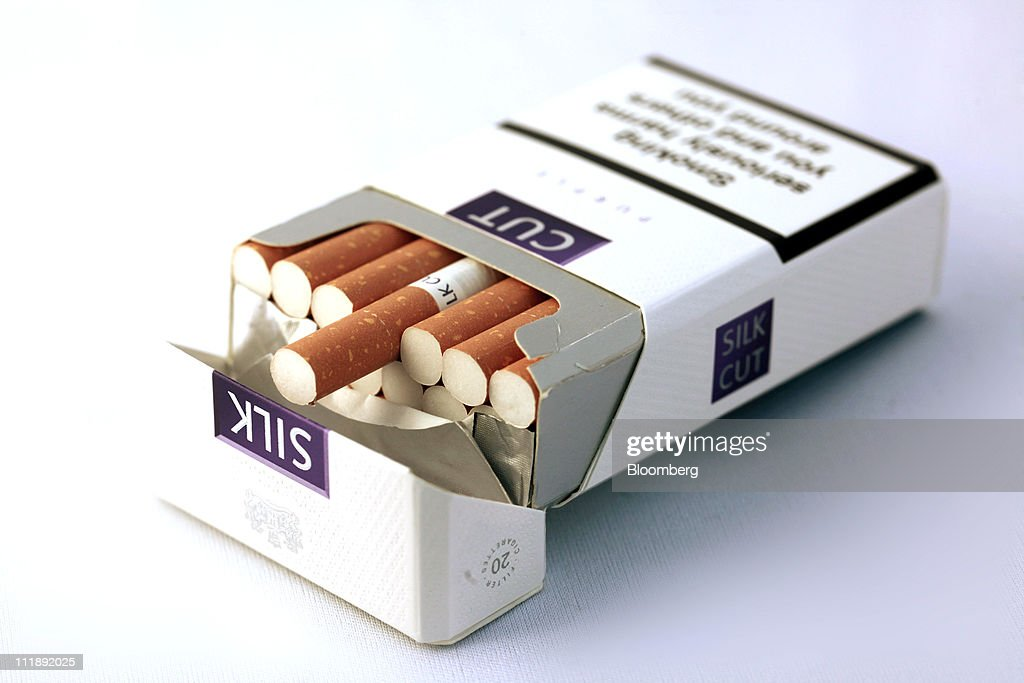 A packet of Silk Cut cigarettes, produced by Japan Tobacco Inc., sit arranged for a photograph in London, U.K., on Thursday, April 7, 2011. The global market for cigarettes excluding China, which is largely closed to foreign tobacco companies, will probably shrink by 2.5 percent in 2011, BAT Chief Executive Officer Nicandro Durante said Feb. 24. Photographer: Jason Alden/Bloomberg via Getty Images