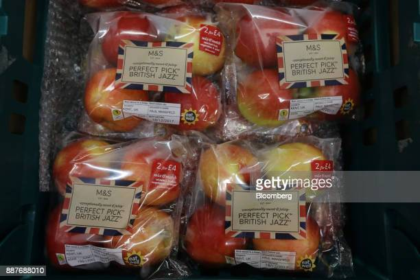Packets of British jazz apples sit on display in the foodhall inside a branch of Marks Spencer Group Plc in London UK on Tuesday Dec 5 2017 Brexit...