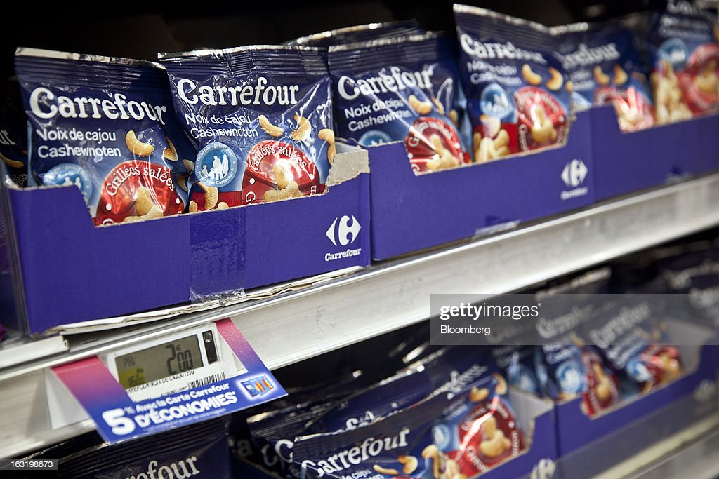 Packets of Carrefour-branded cashew nuts sits displayed for sale inside a Carrefour SA supermarket in Portet sur Garonne, near Toulouse, France, on Tuesday, March 5, 2013. Carrefour's stock has risen 47 percent since Georges Plassat's arrival as chief executive officer, partially offsetting a 71 percent decline in the preceding five years. Photographer: Balint Porneczi/Bloomberg via Getty Images