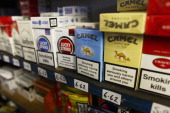 Packets of cigarettes are on display for sale at James Harvie Tobacconist on March 23 in Paisley Scotland The Chancellor is expected to implement...