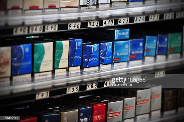 Packets of cigarettes are pictured in a shop in central London on July 12 2013 Britain announced it had postponed plans to introduce plain packaging...