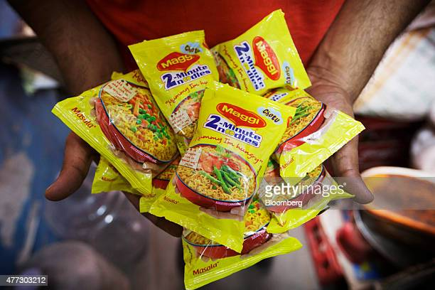 Packets of Maggi 2Minute Noodles manufactured by Nestle India Ltd which were located behind the counter at a store are displayed for a photograph in...
