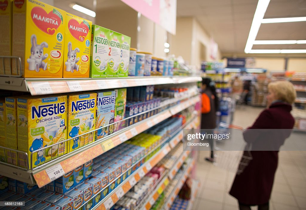 Packets of Nestle SA branded infant nutrition products stand on shelves inside a Dixy supermarket operated by OAO Dixy Group in Moscow, Russia, on Tuesday, April 8, 2014. Suppliers suffering from ruble depreciation this quarter are urging retailers to increase prices. Photographer: Andrey Rudakov/Bloomberg via Getty Images
