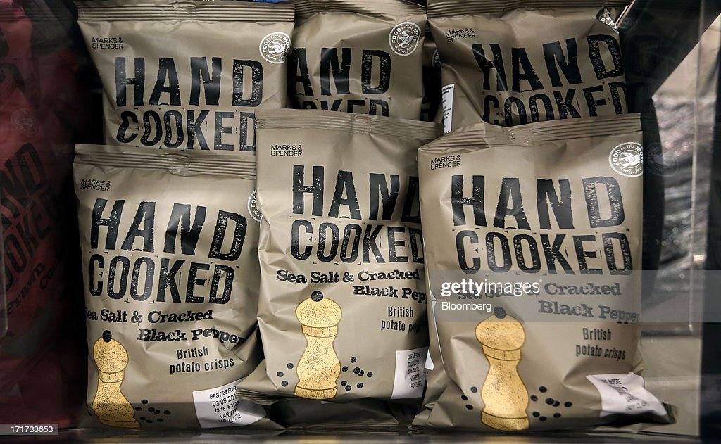Packets of potato chips are seen inside a Marks & Spencer Group Plc (M&S) food hall in the Westfield Stratford City retail complex in London, U.K., on Thursday, June 27, 2013. U.K. retail sales rose more than economists forecast in May as consumers spent more online and food sales increased at their fastest pace for more than two years. Photographer: Chris Ratcliffe/Bloomberg via Getty Images