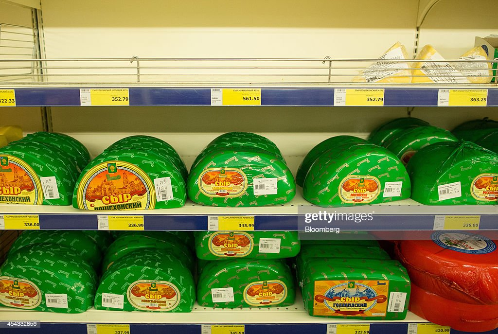 Packets of processed cheese sit for sale beneath empty shelves inside a Metro Cash & Carry store, the Russia unit of Metro AG, in Moscow, Russia, on Friday, Aug. 29, 2014. Metro Cash & Carry has warned that domestic food suppliers are trying to increase some food prices as local produce is substituted for EU, Norwegian and U.S. equivalents which have been sanctioned. Photographer: Andrey Rudakov/Bloomberg via Getty Images