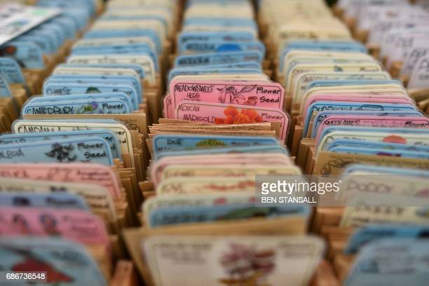 Packets of seed for sale are seen at the 2017 Chelsea Flower Show in London on May 22 2017 The Chelsea flower show held annually in the grounds of...