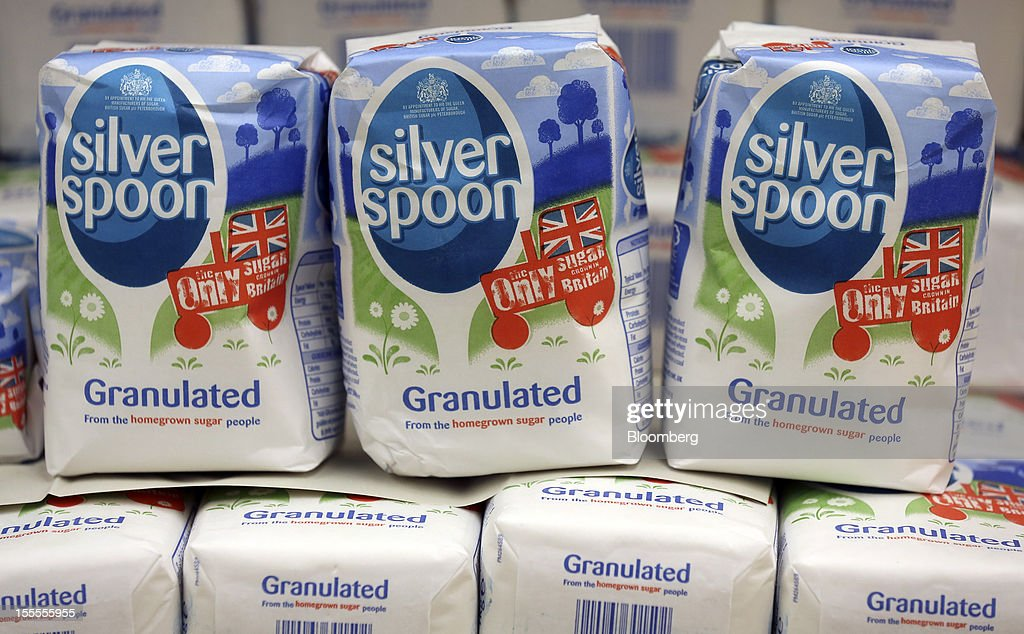 Packets of Silver Spoon granulated sugar, produced by Associated British Foods Plc, sits displayed for sale at a supermarket in London, U.K., on Monday, Nov. 5, 2012. AB Foods shares have gained 17 percent this year, fueled by the growth of the sugar unit and Primark, the company's two main profit contributors. Photographer: Simon Dawson/Bloomberg via Getty Images