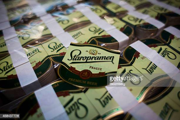 Packets of Staropramen beer bottle labels sit ahead of use at the Pivovary Staropramen AS brewing company operated by Molson Coors Brewing Co in...
