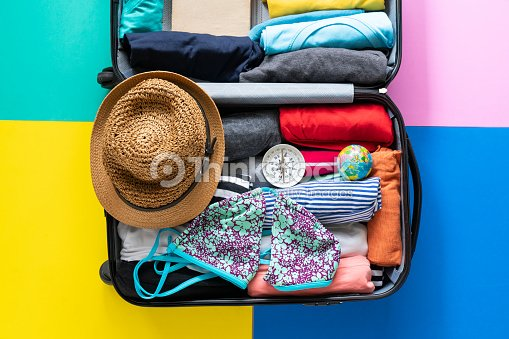 packing a luggage for a new journey and travel for a long weekend : Stock Photo
