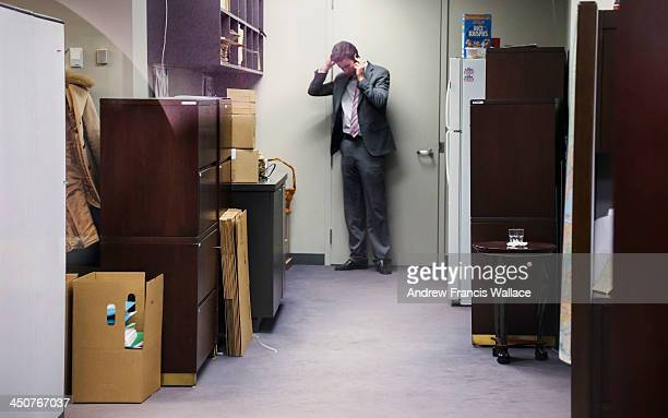 Packing boxes sit near one of Mayor Rob Ford staff talking on his cell phone at City Hall November 19 2013