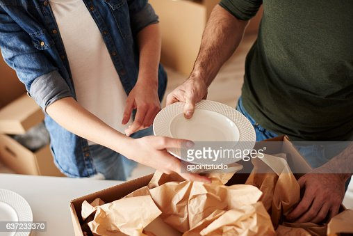 Packing dinnerware to the boxes : Stock Photo