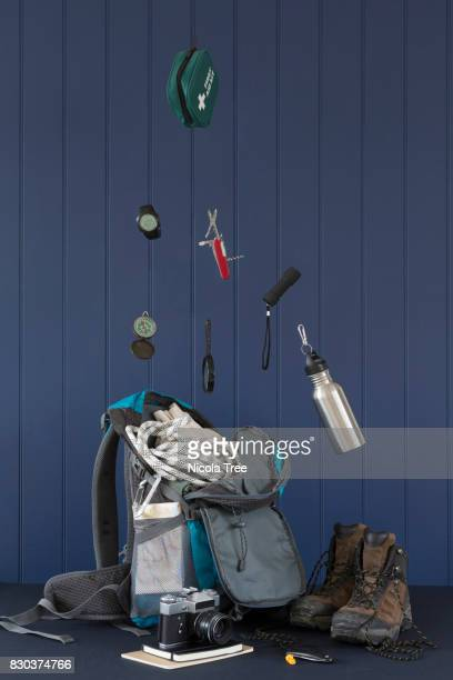 Packing items flying into a rucksack for a activity holiday