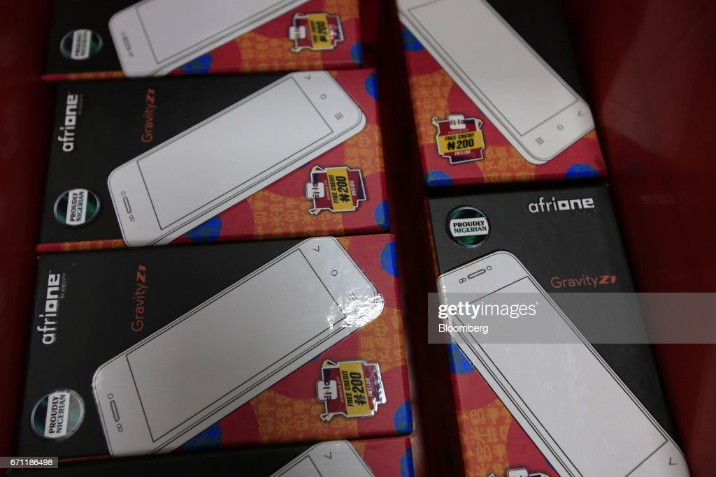 Packs containing new AfriOne Gravity Z1 smartphones sit ready for distribution during a launch event at the new AfriOne Ltd. manufacturing plant in Lagos, Nigeria, on Friday, April 21, 2017. The plant has the capacity to produce some 120,000 units per month. Photographer: George Osodi/Bloomberg via Getty Images