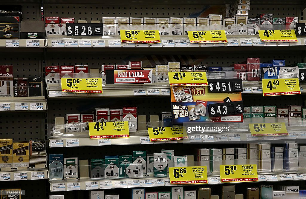 Packs of cigarettes are displayed on a shelf at a CVS store on February 6 2014 in Greenbrae California CVS Caremark announced Wednesday that it will...