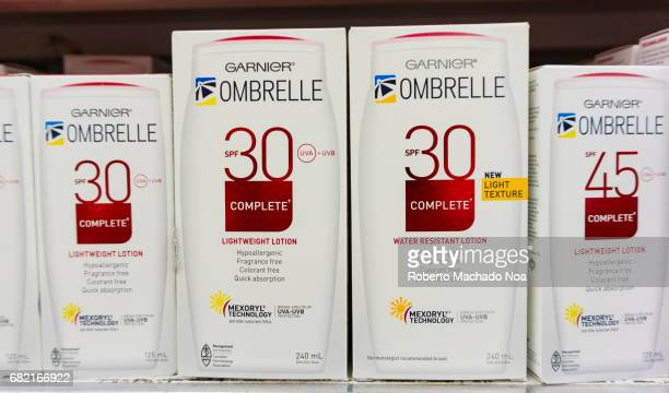 Packs of Garnier Sunscreen Lotion on display for sale Lightweight with high content of SPF