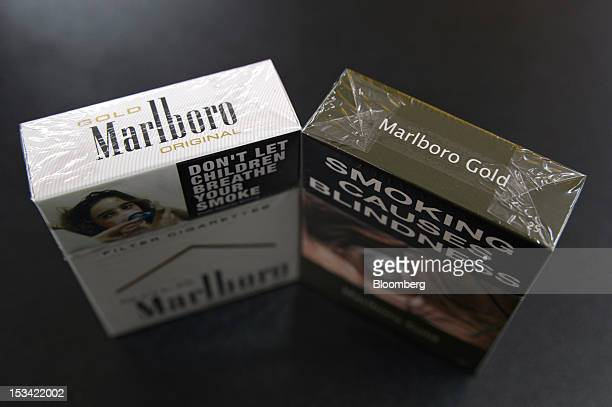 Packs of Philip Morris International Inc Marlboro Gold cigarettes in the new packaging right and old packaging are arranged for a photograph at a...
