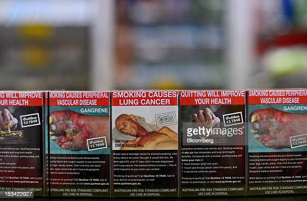 Packs of Philip Morris International Inc Marlboro Menthol cigarettes in the new packaging are arranged for a photograph at a tobacco store in...