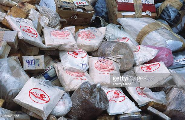 Packs of pure heroin and opium that have been brought to a drugburning ceremony
