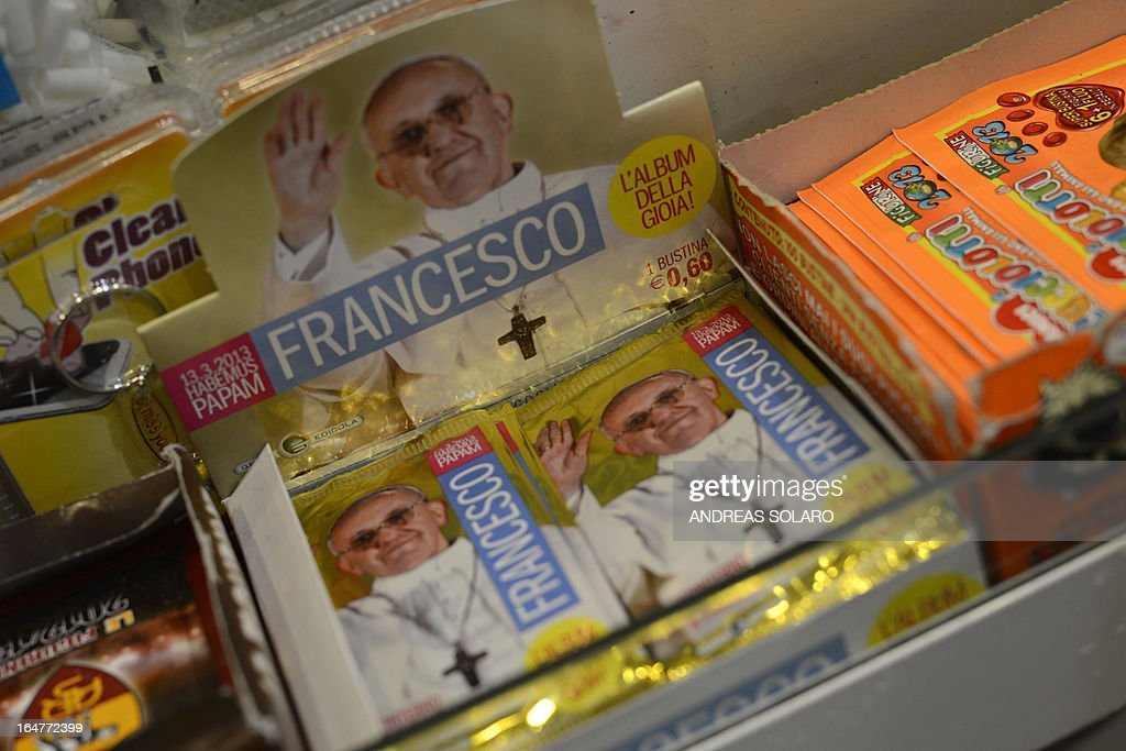 Packs of stickers dedicated to Pope Francis to collect in an album of 400 images are on sale in a tobacco and newspapers seller on March 28, 2013 in Rome. A pack of five stickers costs 0,60 euro.