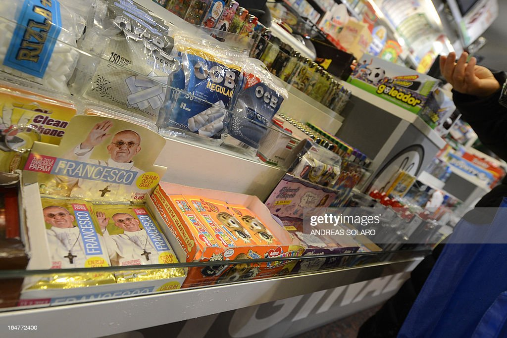 Packs of stickers dedicated to Pope Francis(L) to collect in an album of 400 images are on sale in a tobacco and newspapers seller on March 28, 2013 in Rome. A pack of five stickers costs 0,60 euro.