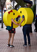PacMan and Ms PacMan cosplayers attend ComicCon International on July 22 2016 in San Diego California